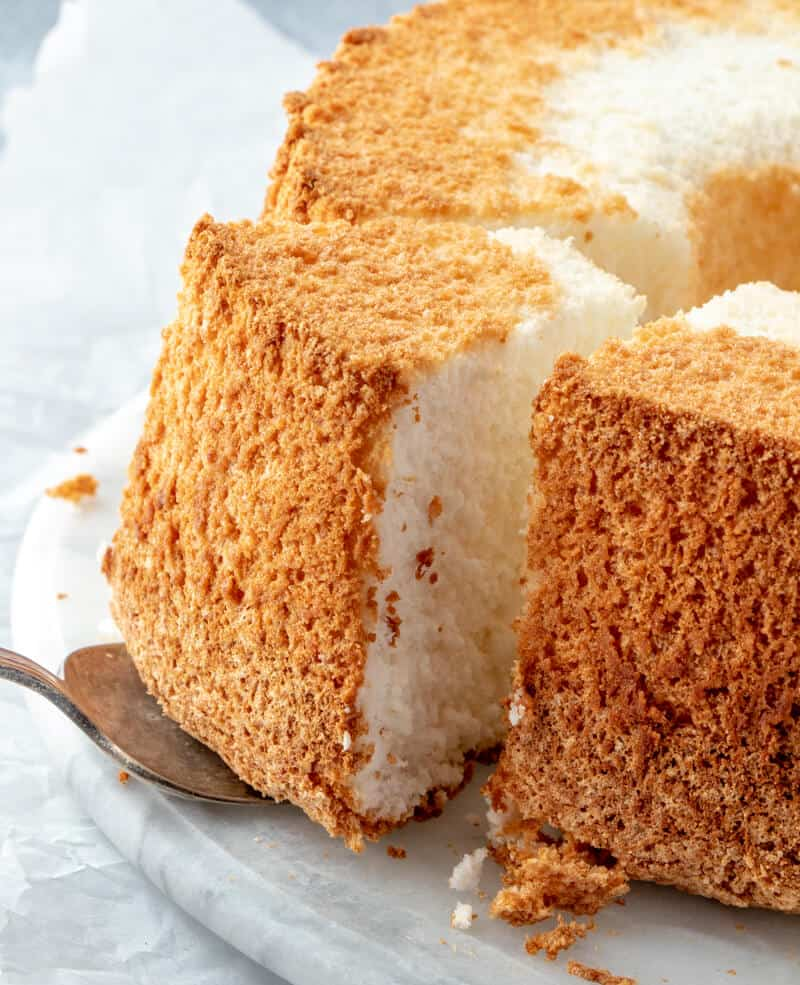 Angel food cake with slice on cake server