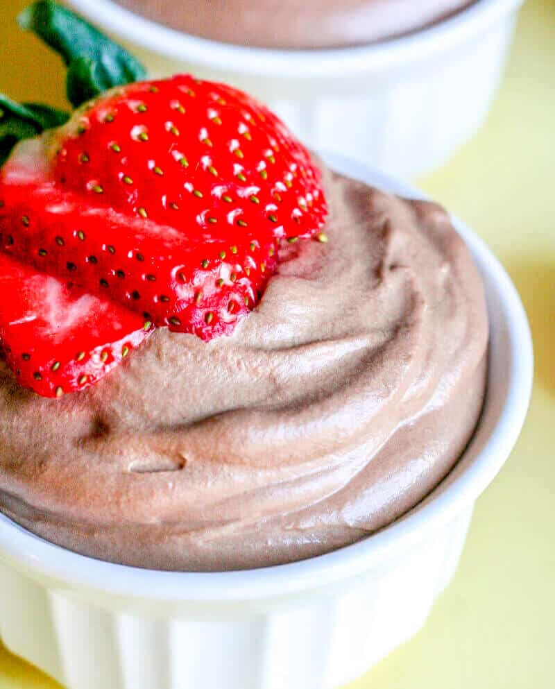 Chocolate Mousse in ramekin with sliced strawberry on top