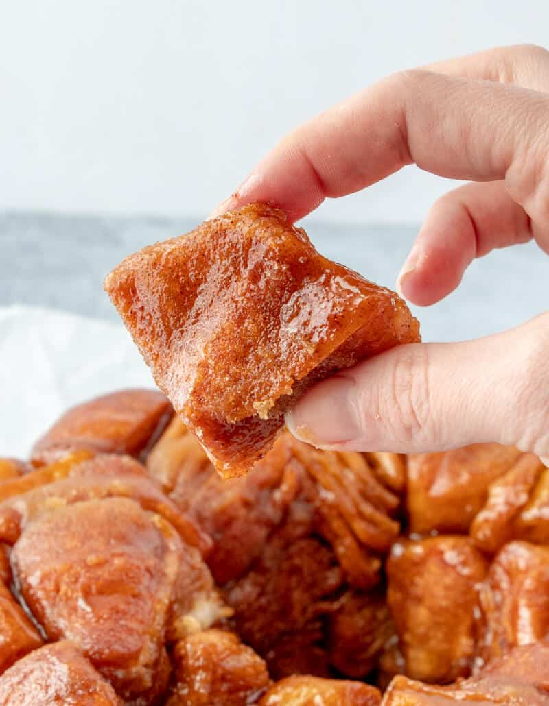 Hand holding piece of monkey bread
