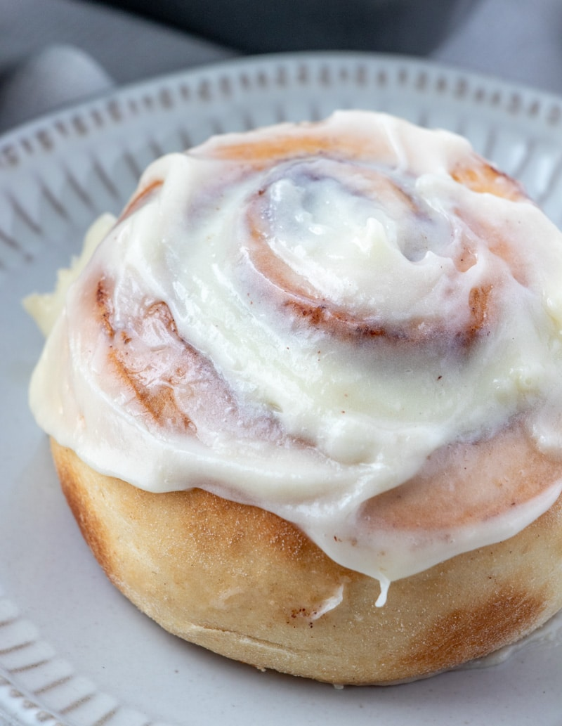 One Hour Cinnamon Roll on plate with icing