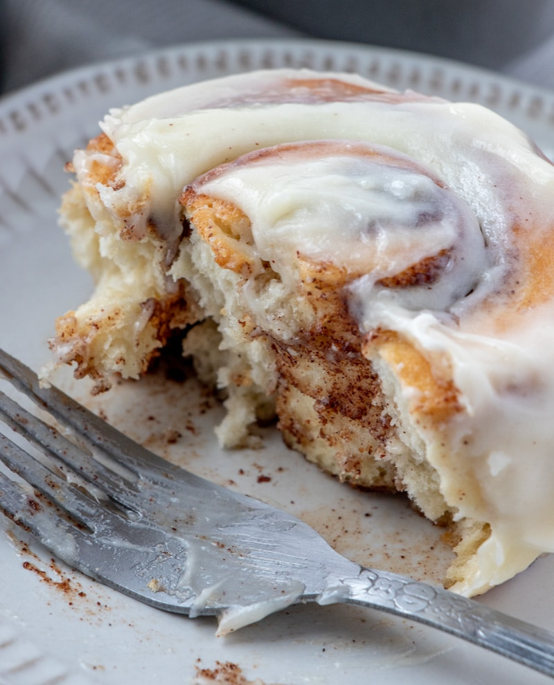 Cinnamon Rolls cut in half inside showing with fork