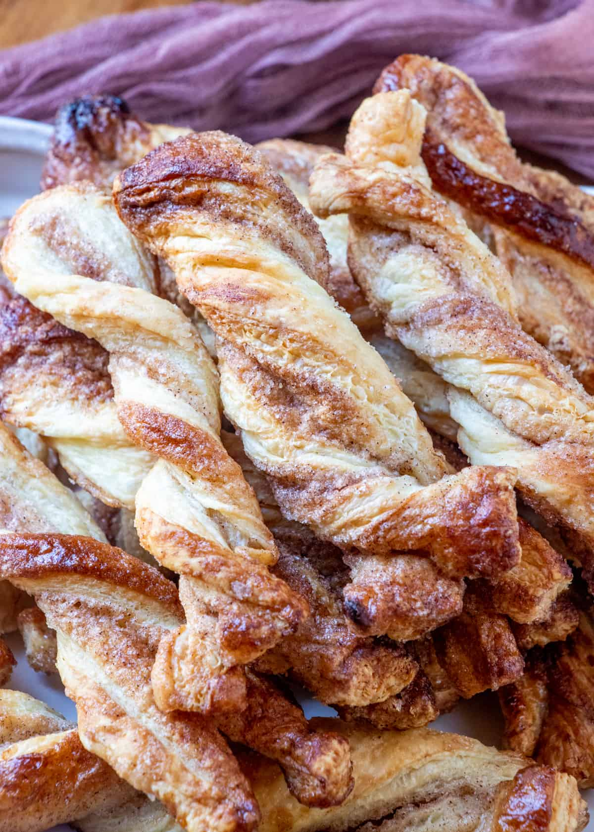 Up close photo of baked twists showing the cinnamon and sugar