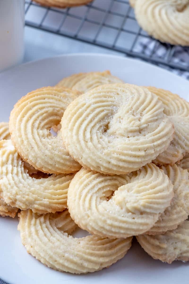 Danish Butter Cookies on white plate close up showing sugar on top