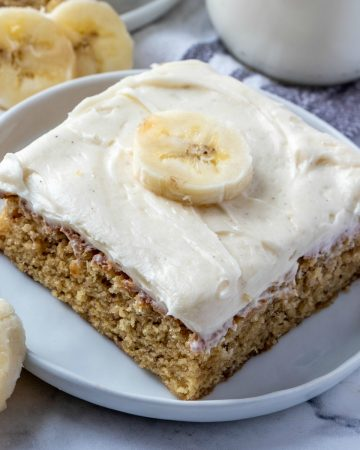 Featured image of banana bar on white plate topped with a banana slice