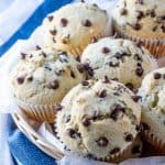 Chocolate Chip Muffins in basket stacked on top of one another