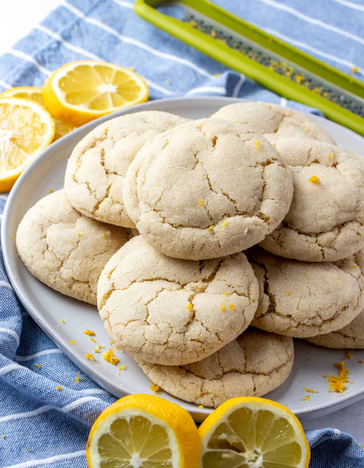 Cookies on plate stacked on top of one another garnished with lemons