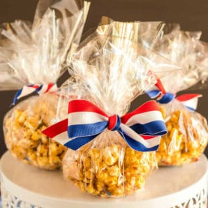 White Chocolate Popcorn recipe in bags on cake stand