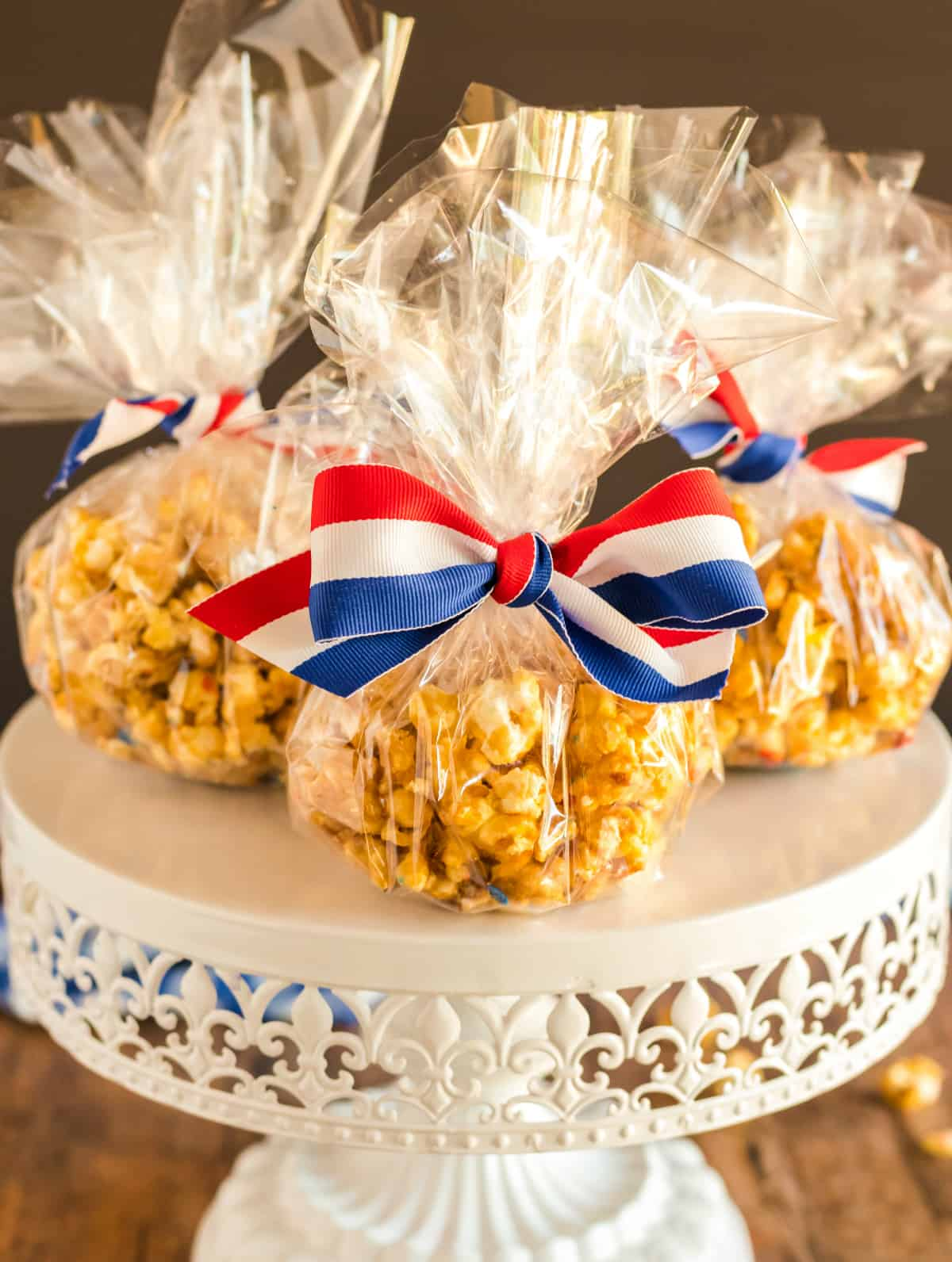 Bags of popcorn on cake stand