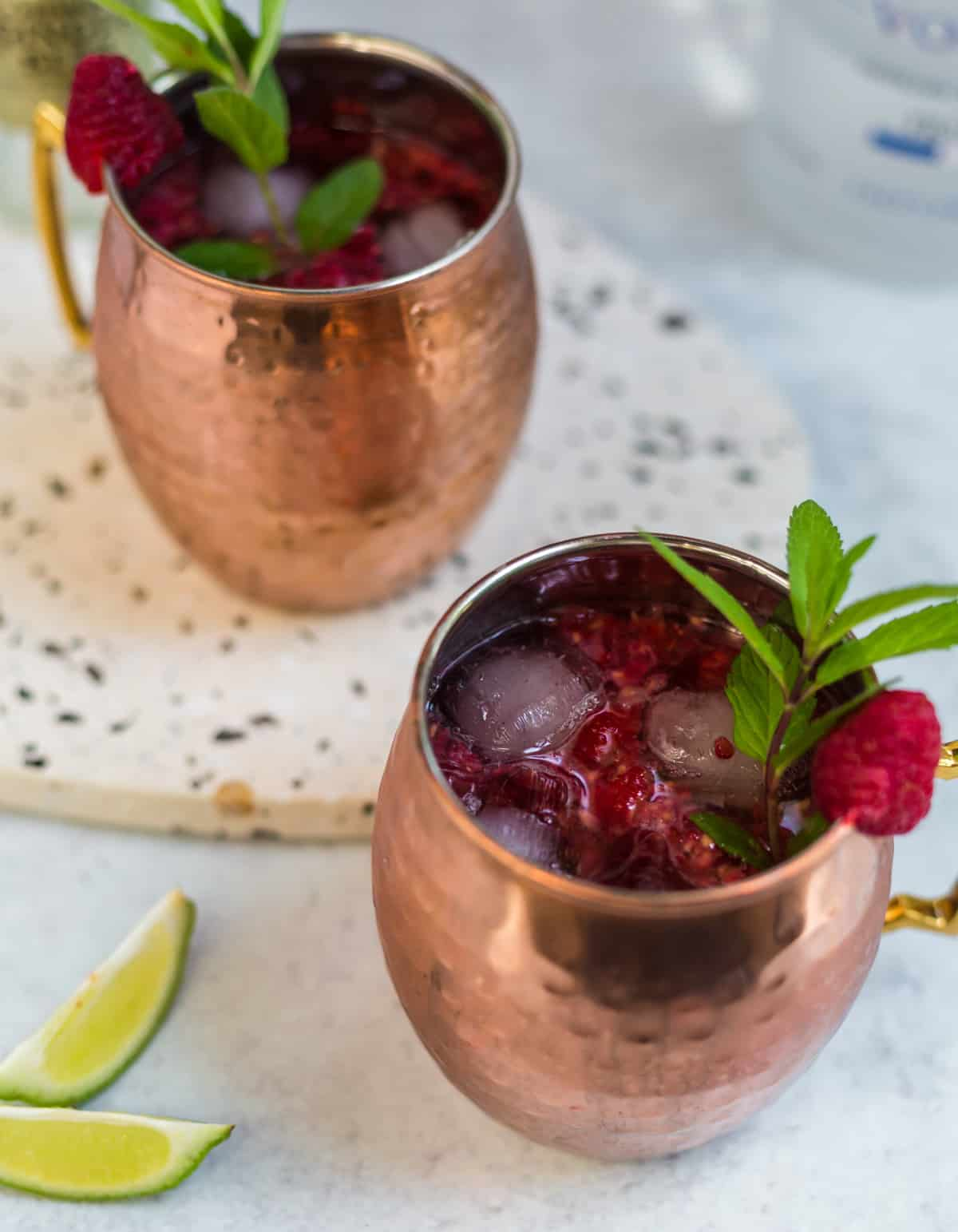 Moscow Mules in copper mugs with lime wedges as garnish