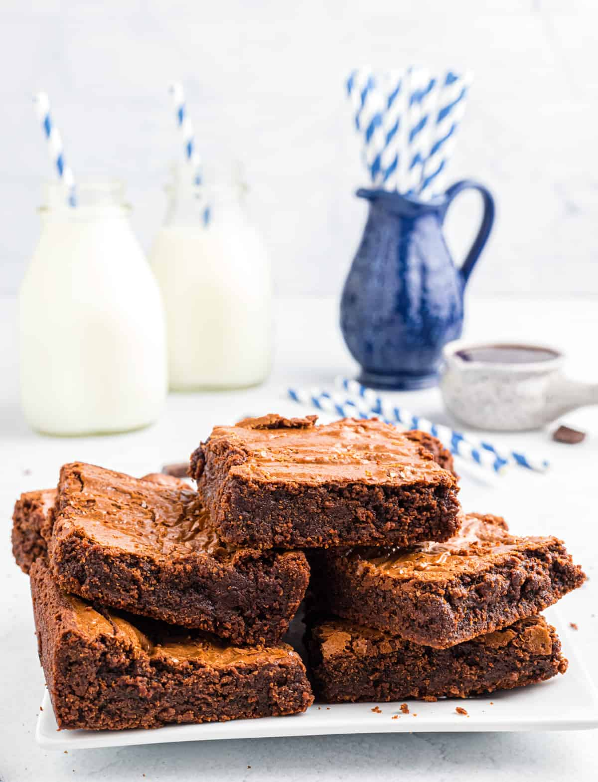 Stacked brownies on white plate
