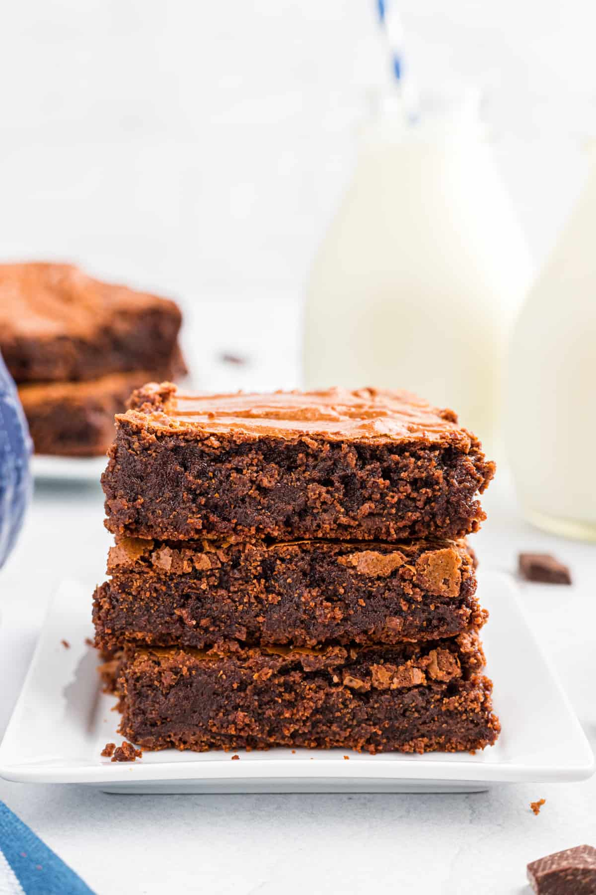 Three stacked brownies on top of one another
