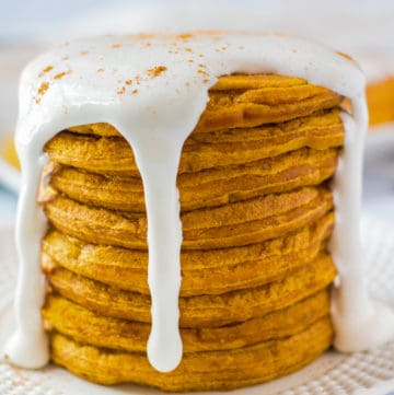 Close up of stacked pancakes with marshmallow drizzle