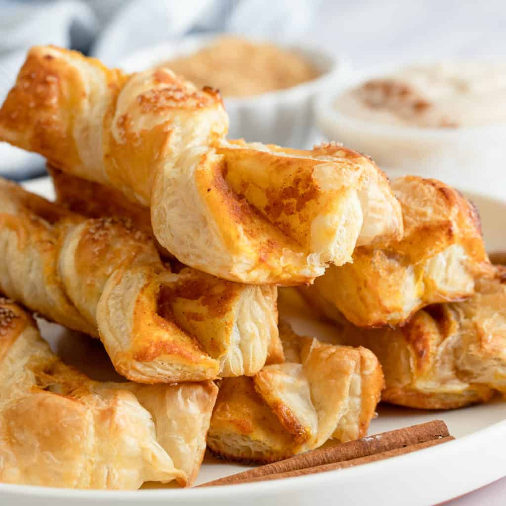 Puff Pastry Twists on white plate close up square image
