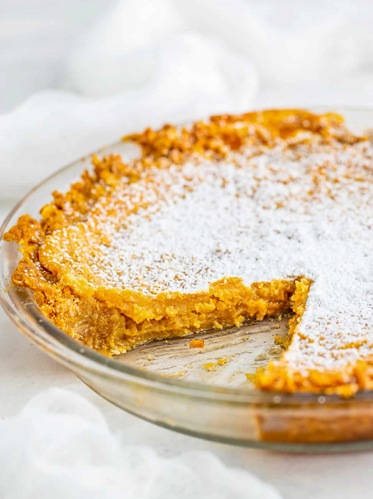 Pie in pie plate with slice missing