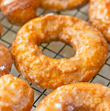 Close up of donuts on cooling rack