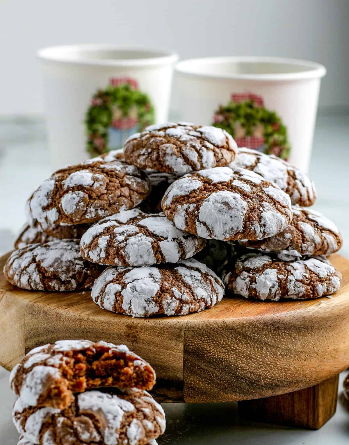Side view of Chocolate Crinkle Cookies on wooden stand