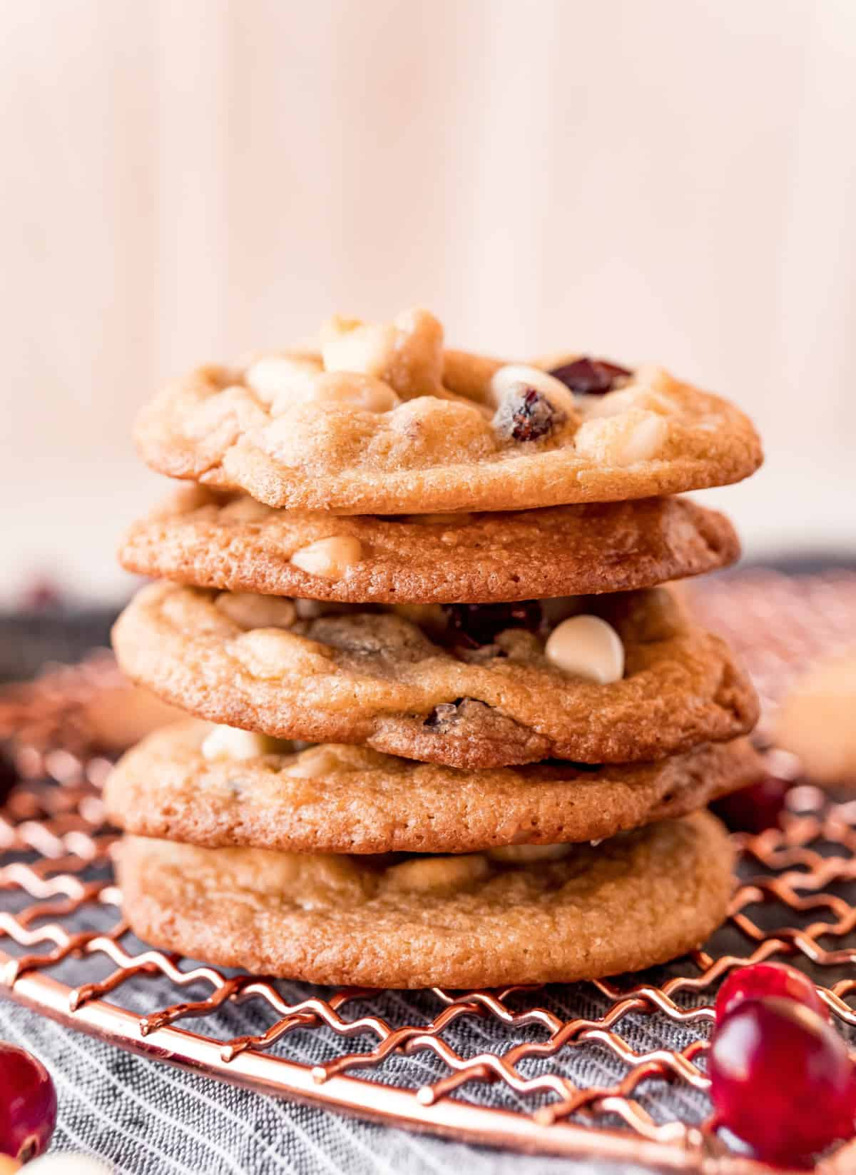 Macadamia Nut Cookies stacked on cooling rack