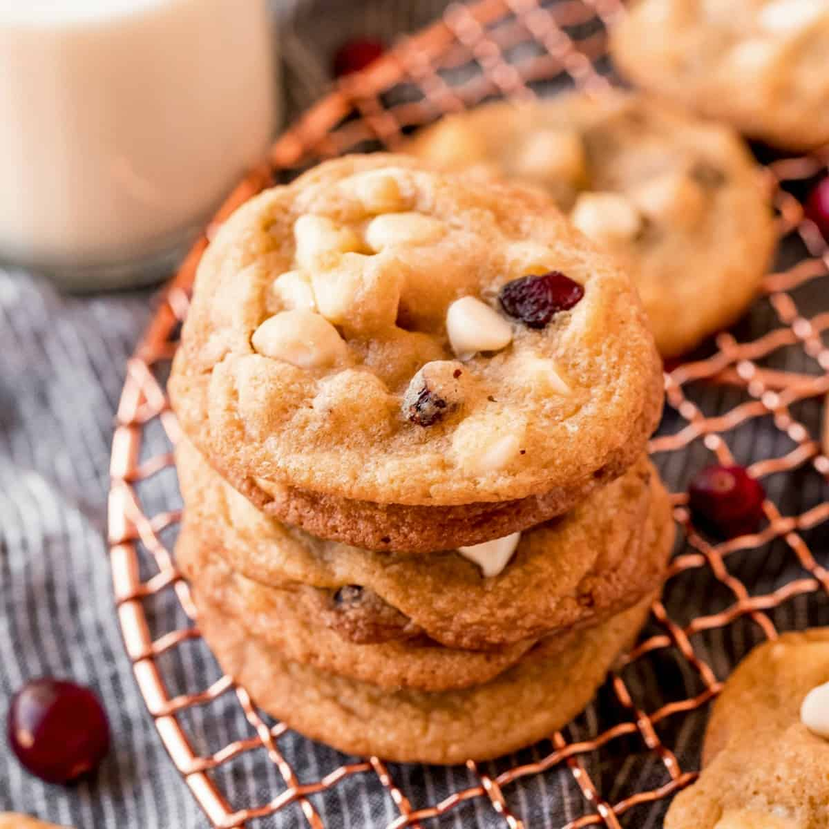 Macadamia Nut Cookies stacked on cooling rack square image