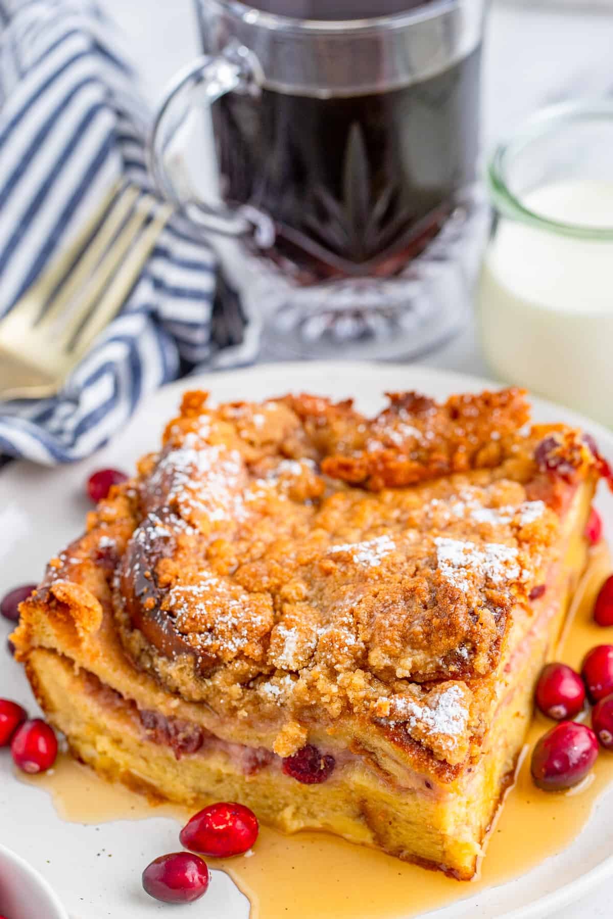 Cranberry Overnight French Toast on plate drizzled in syrup