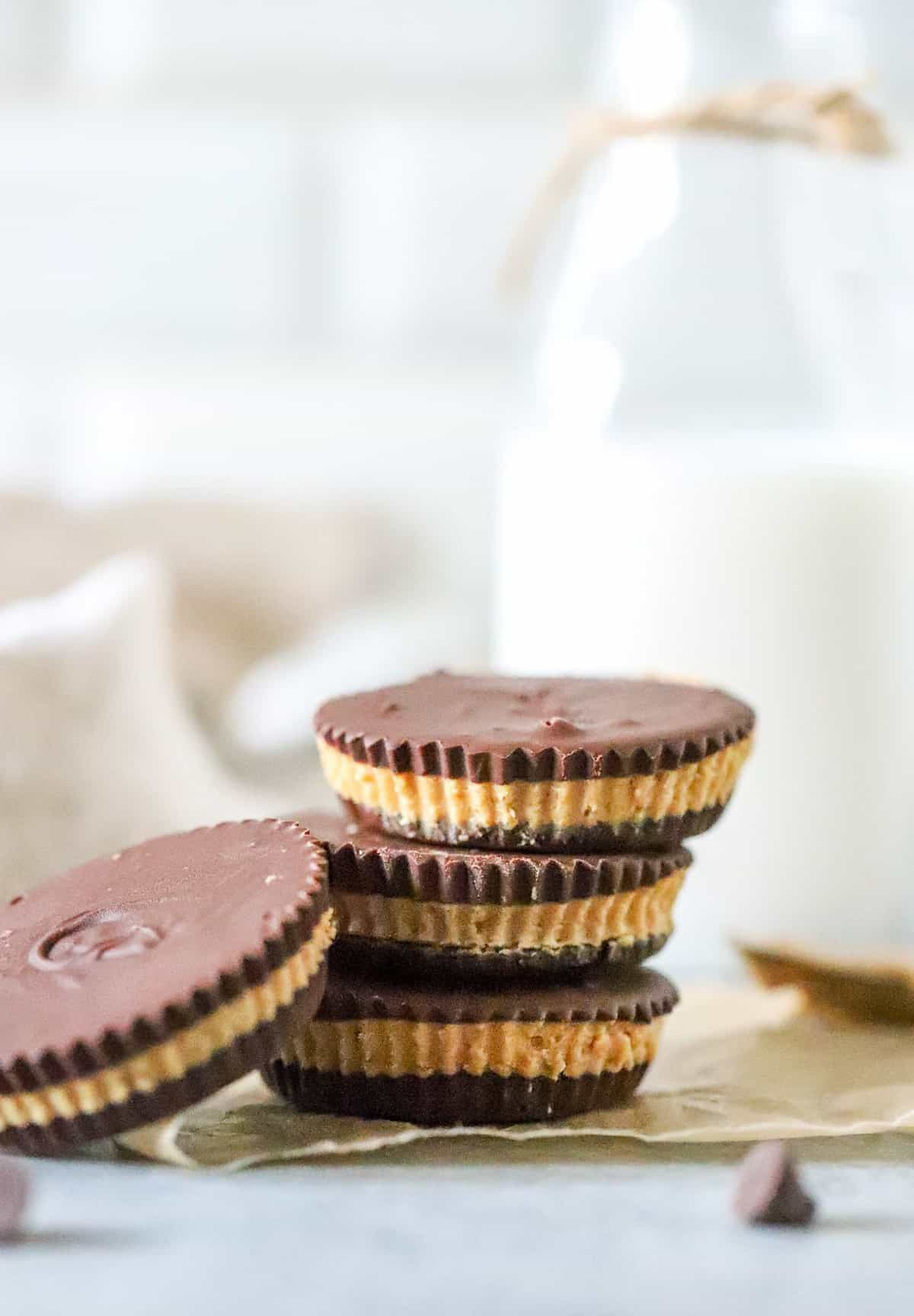Three stacked Peanut Butter Cups with one leaning on side of stack