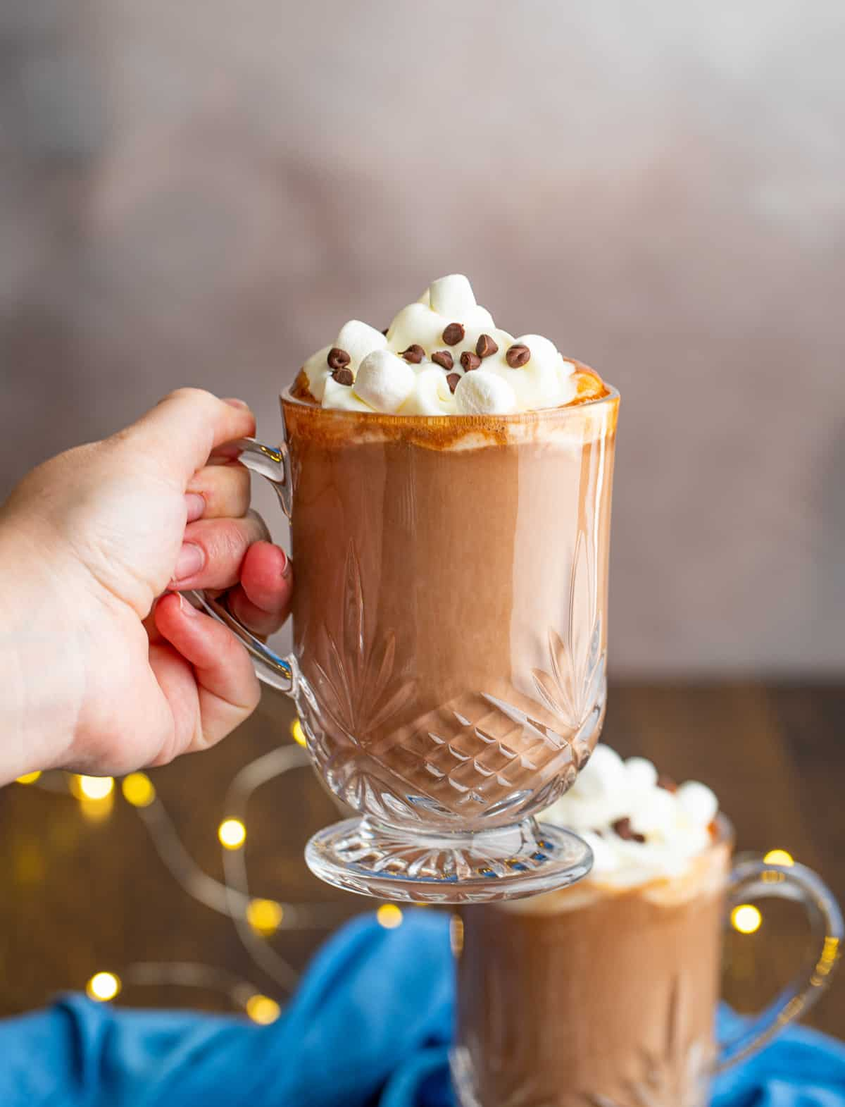 Hand holding clear much of Spiked Hot Chocolate