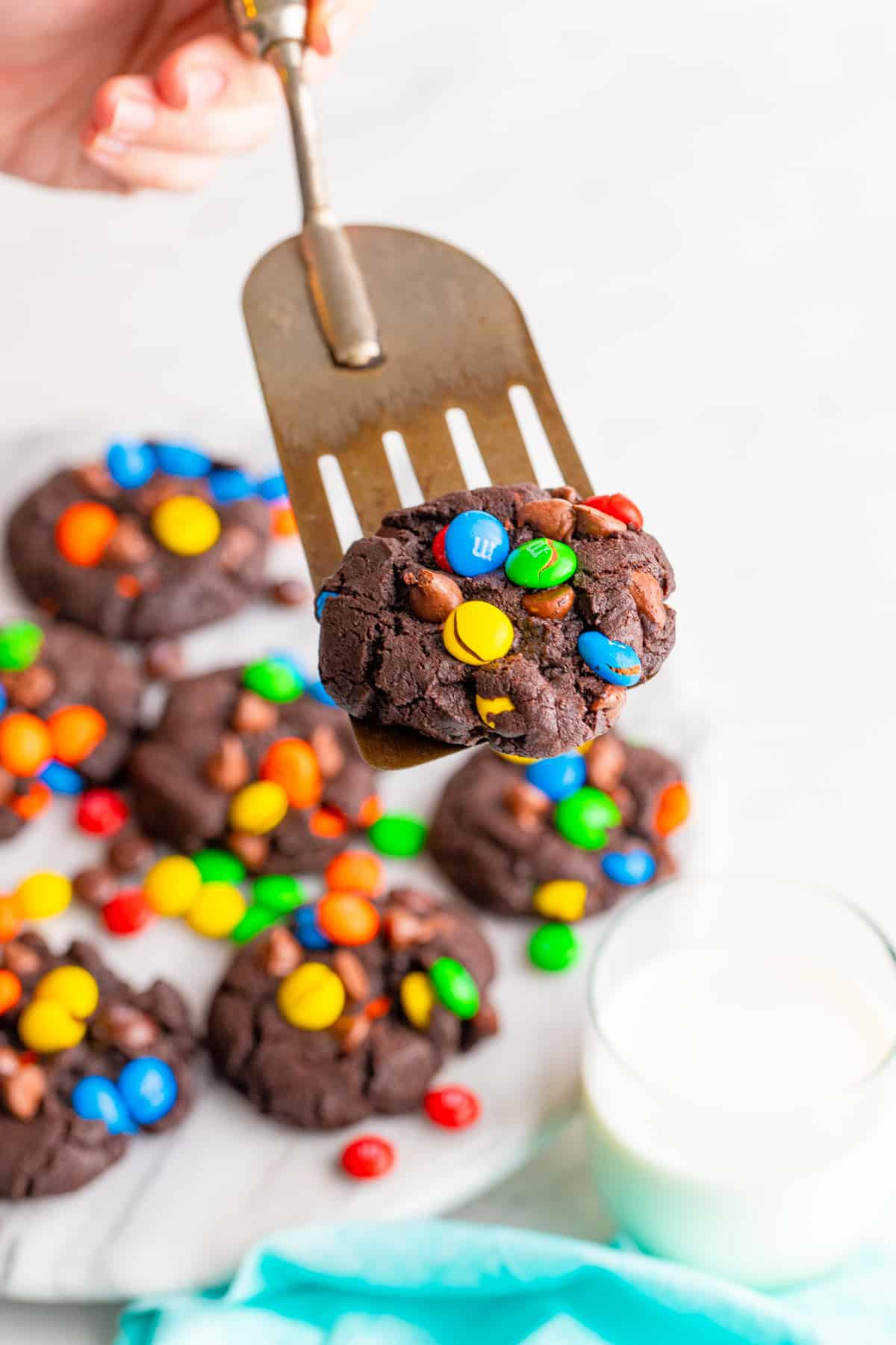 Spatula holding up one Chocolate M&M Cookie