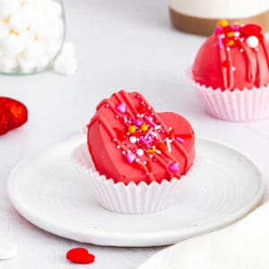 Red Velvet Hot Cocoa Bomb on plate in cupcake liner square image