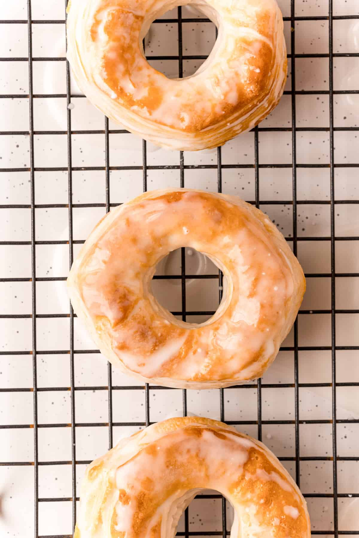 Air Fryer Donuts on wire rack glazed