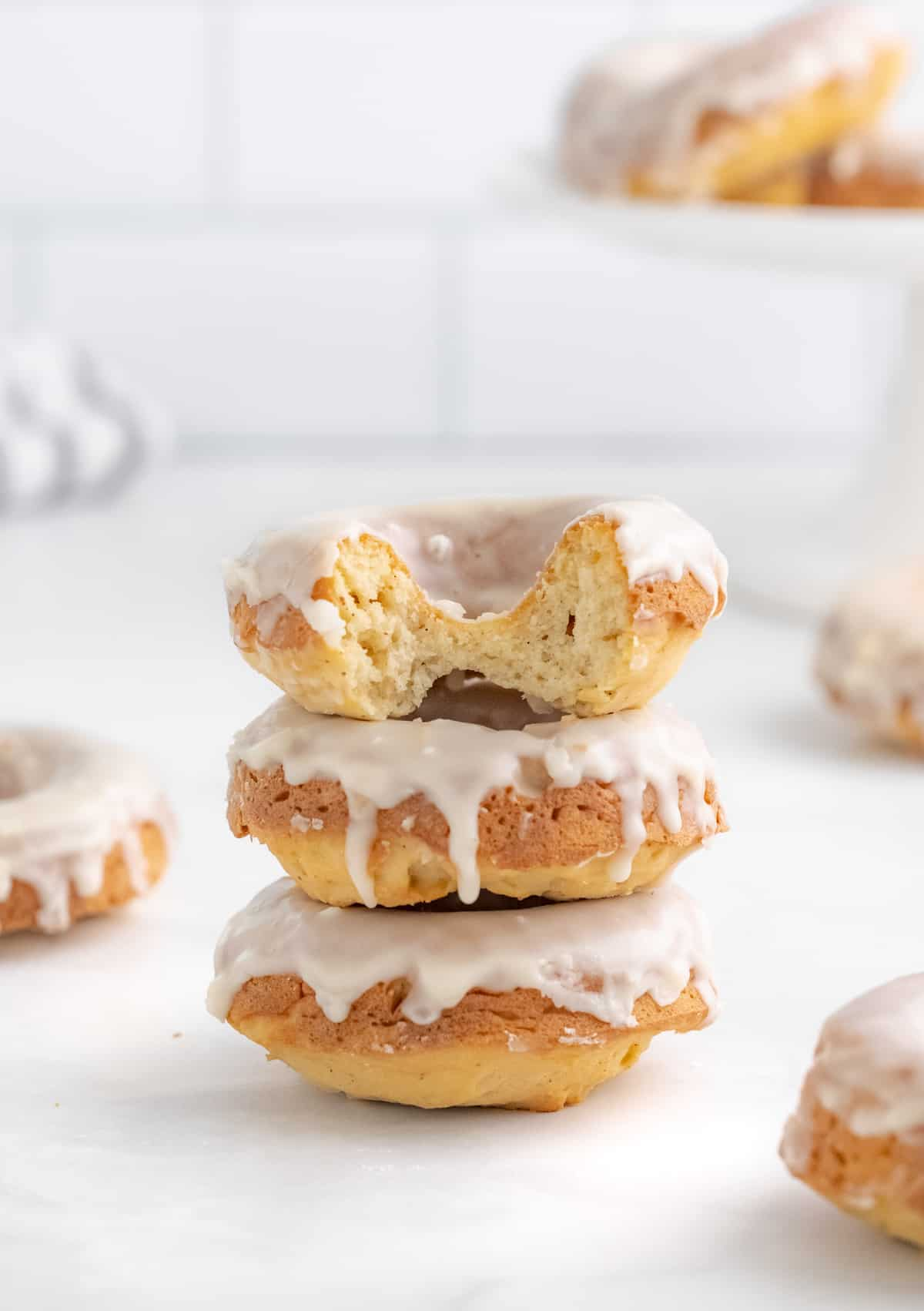 Stacked Baked Donuts with bite taken out of top one