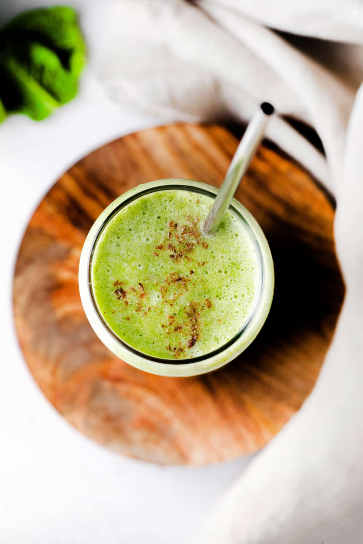 Overhead photos of smoothie with straw and cinnamon