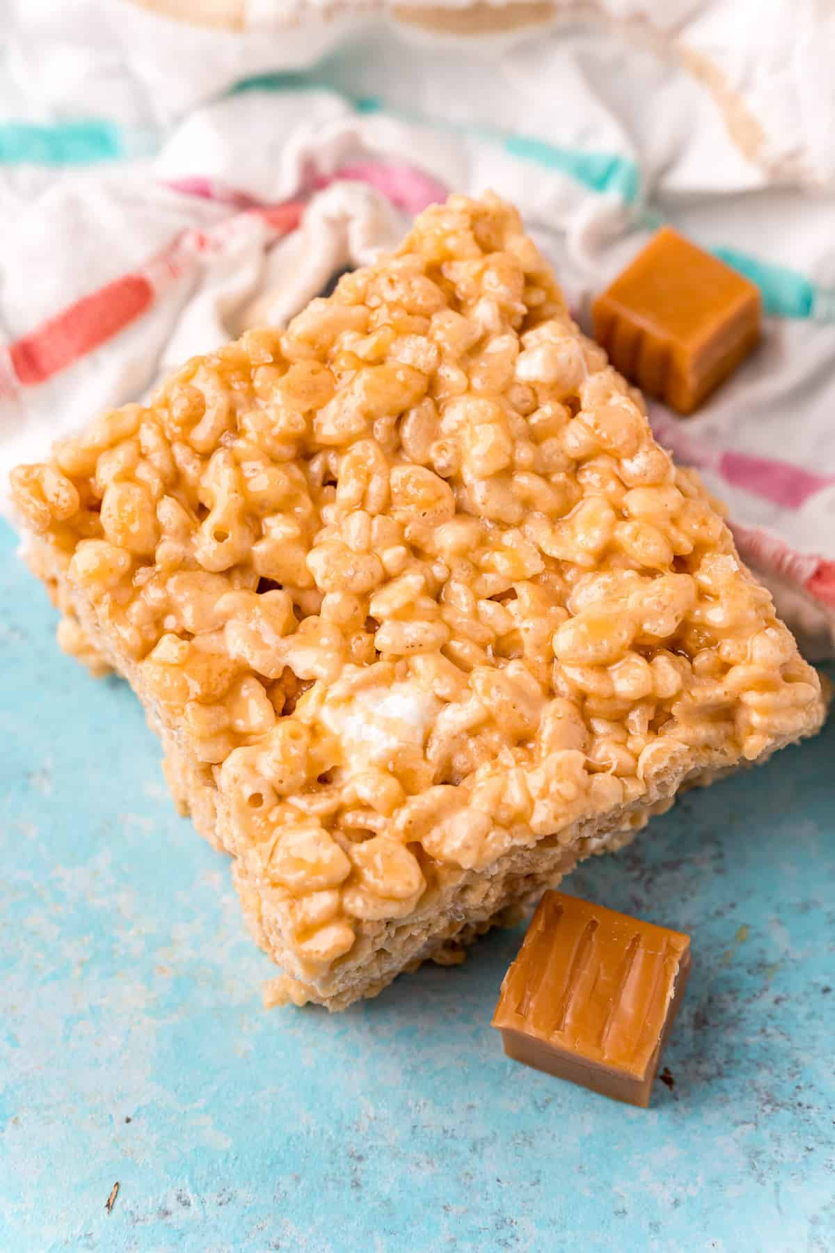 One Salted Caramel Rice Krispie Treat next to caramels