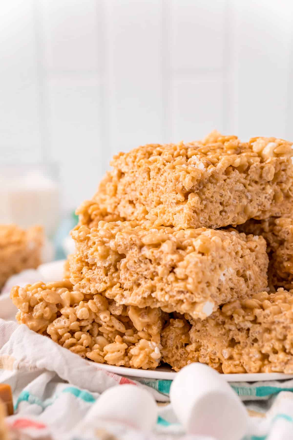 Side view of stacked Salted Caramel Rice Krispie Treats