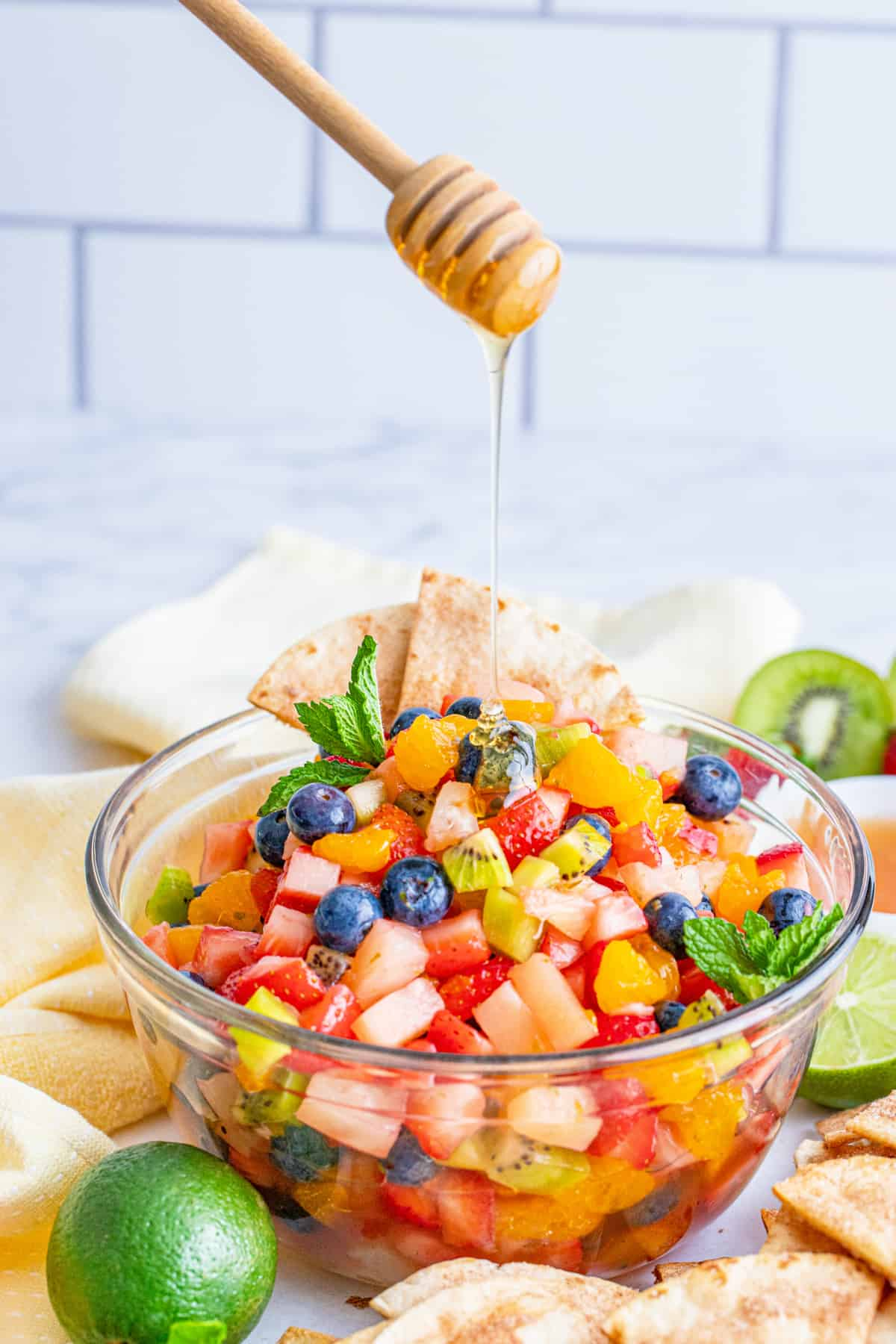 Honey being drizzled over Fruit Salsa