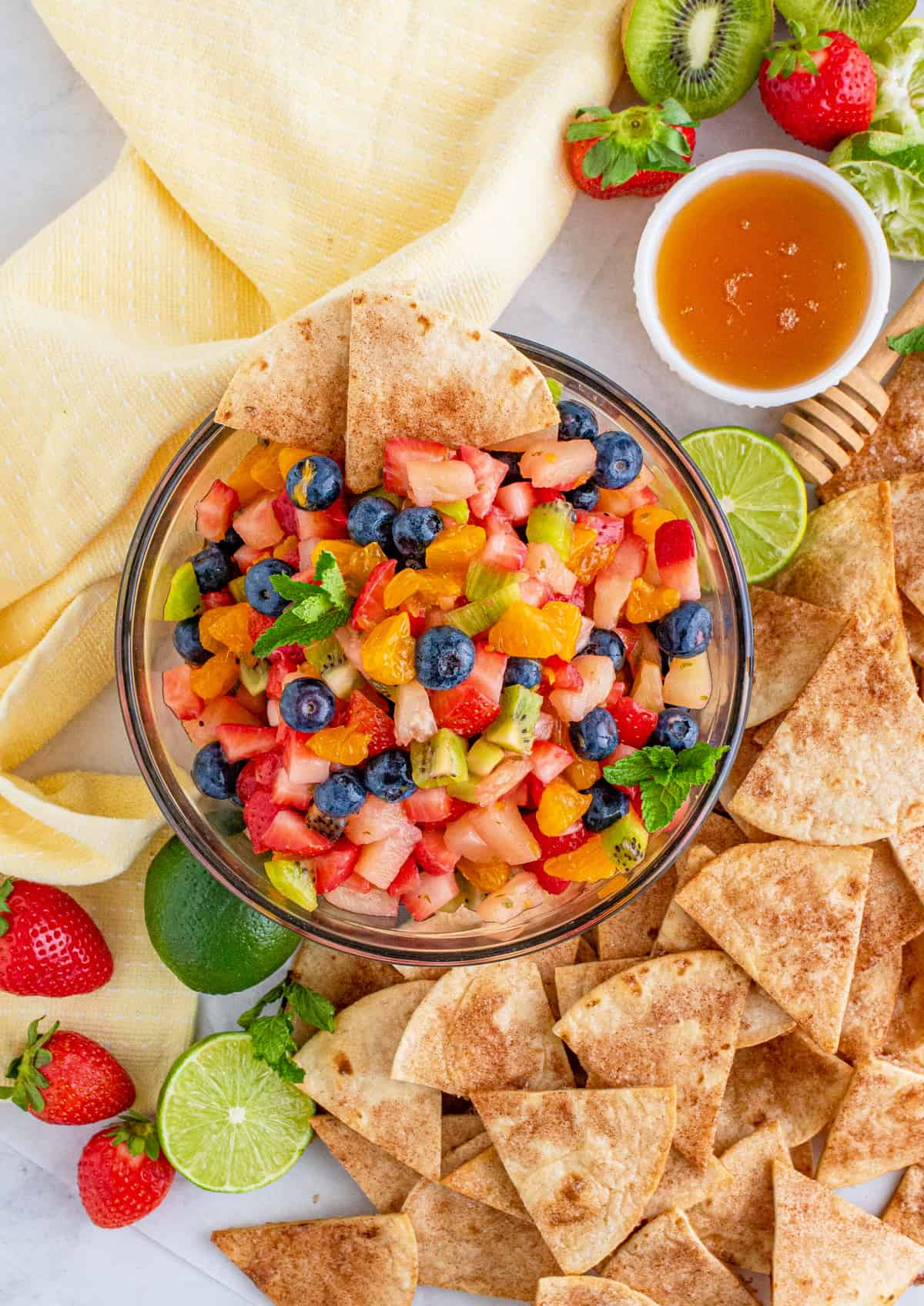 Overhead of finished Fruit Salsa surrounded by fruit and chips