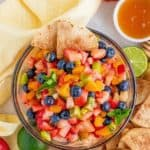 Overhead of Fruit Salsa in bowl surrounded by chips pinterest image