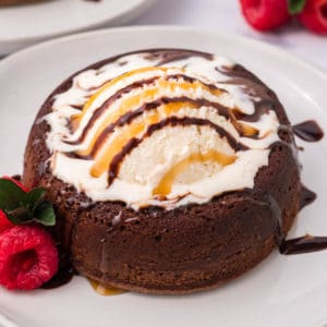 Square image of Lava Cake finished and topped with ice cream, caramel and chocolate syrup