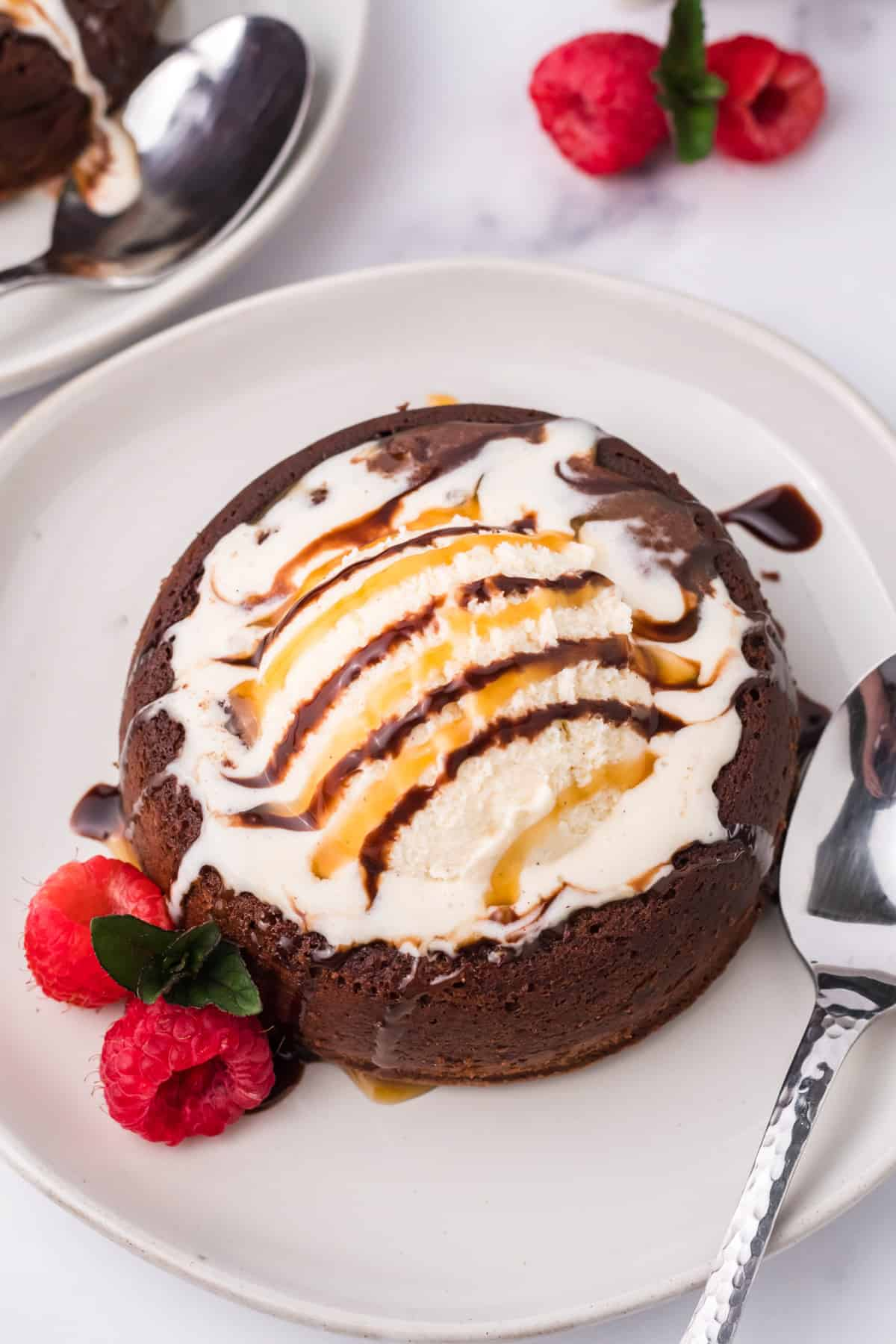Overhead of Lava Cake Recipe topped with ice cream and syups