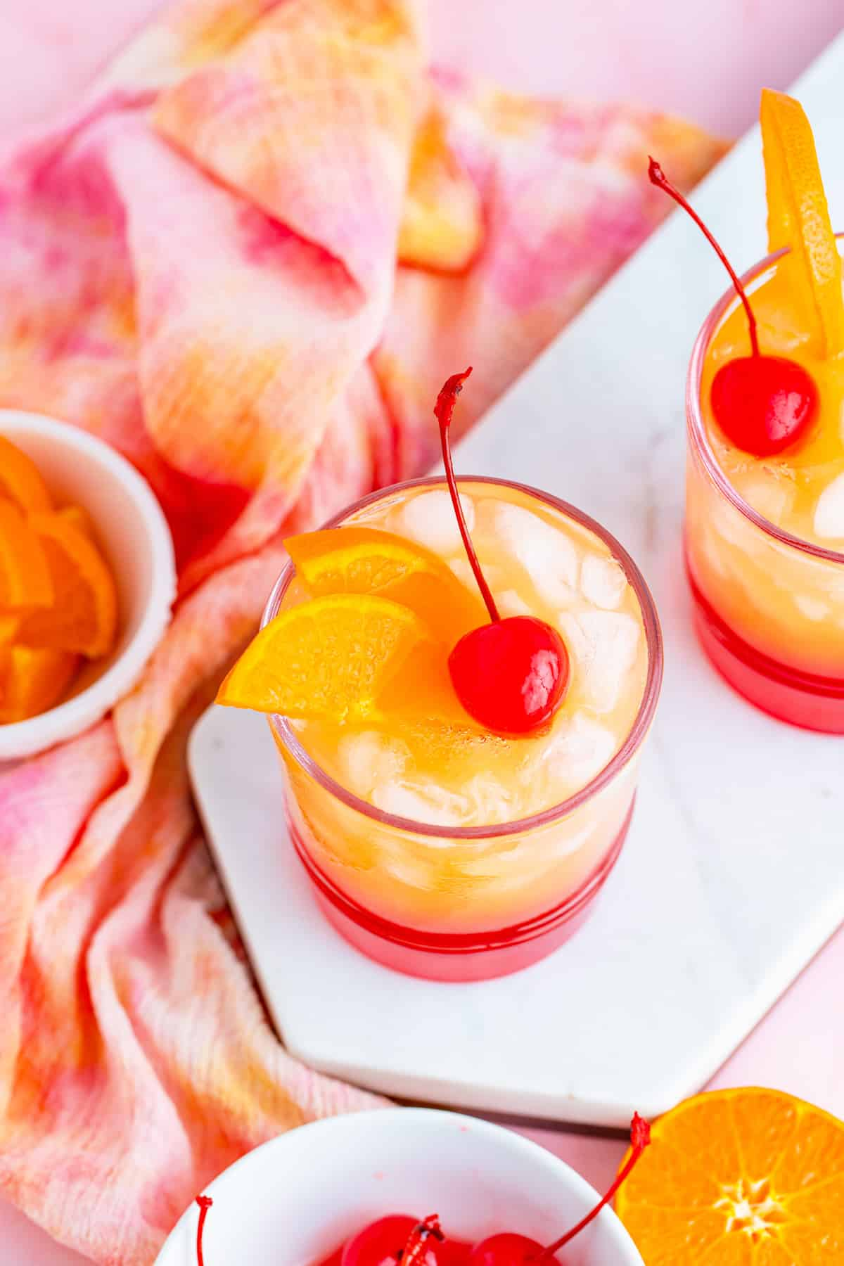 Overhead photo of two Malibu Sunset Cocktails on white platter