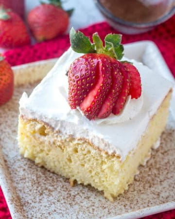 Close up overhead image of a slice of Tres Leches Cake Recipe on white plate