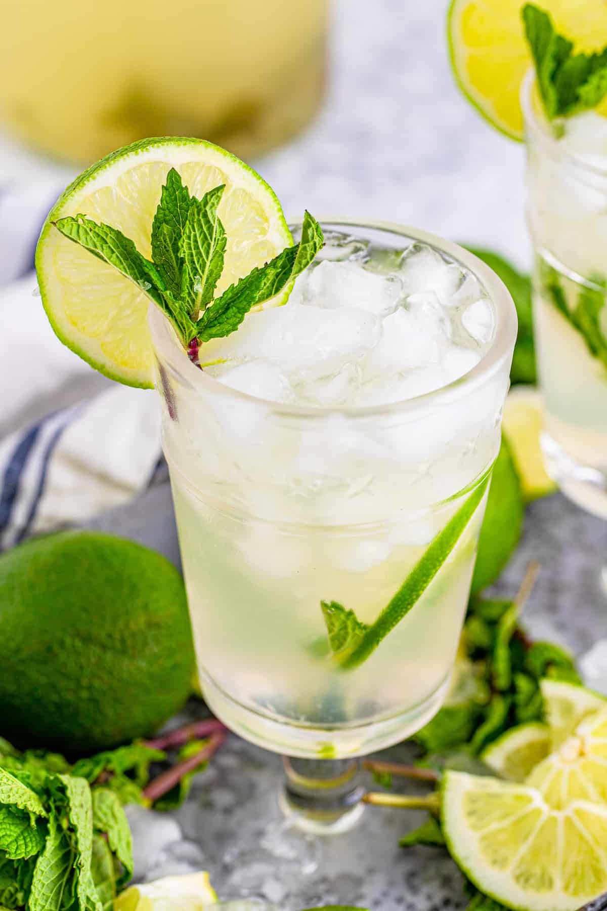Close up of on glass of Pitcher Mojitos with ice, lime and mint