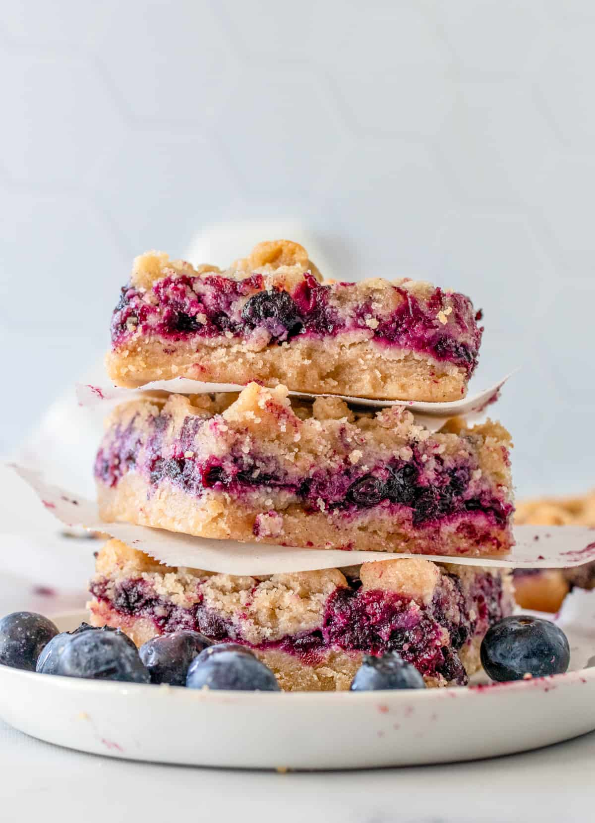 Three stacked Blueberry Bars on white plate
