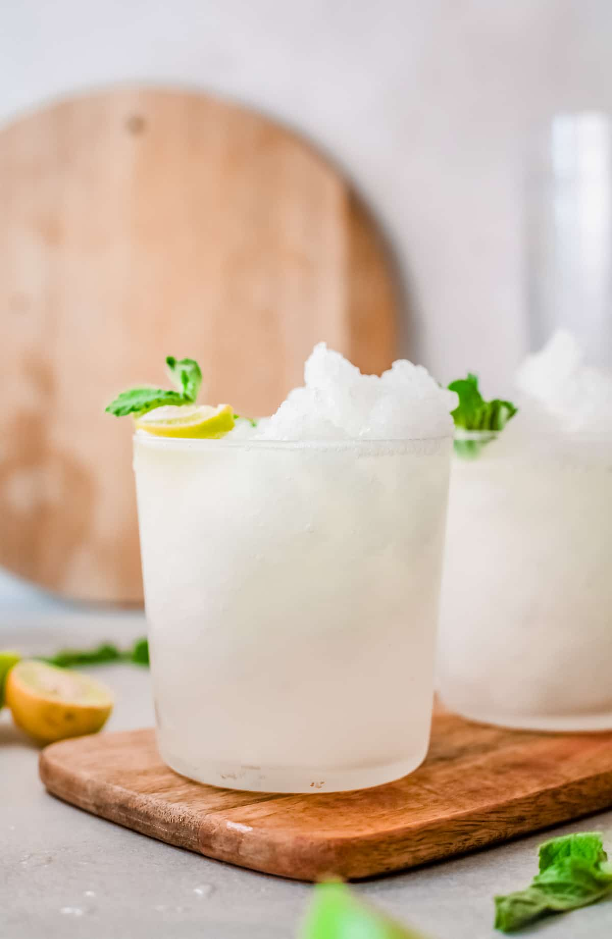 Close up of one Frozen Caipirinha Recipe with lime and mint