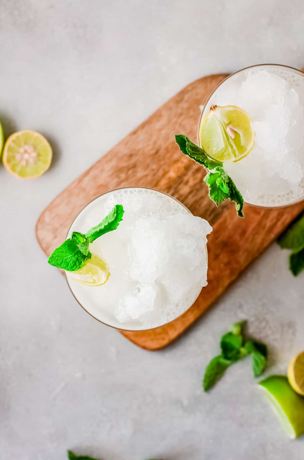 Overhead photo of drinks garnished with lime and mint
