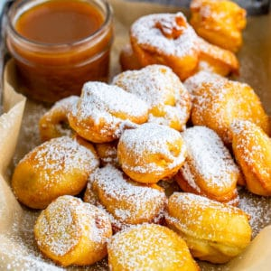 Square image of Banana Funnel Cake Bites topped with powdered sugar