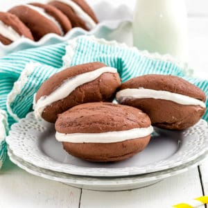 Three cookies on white plate square image