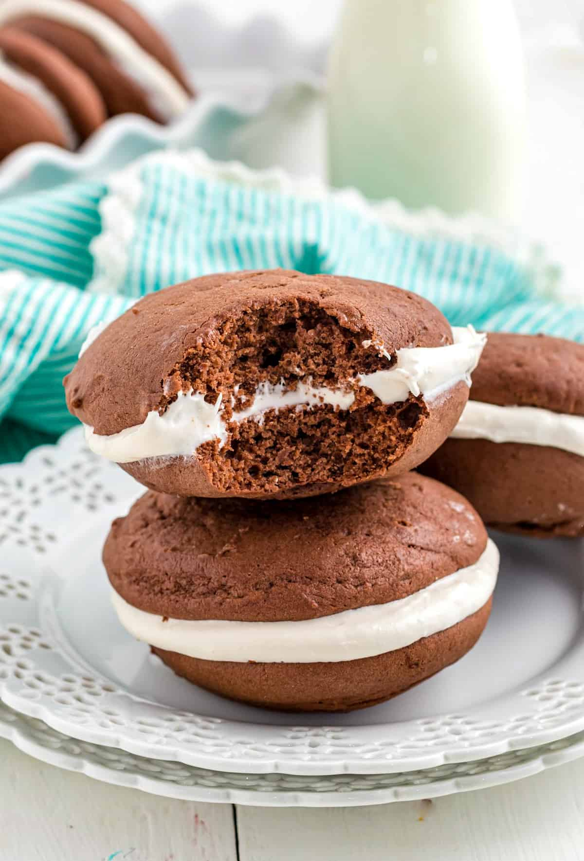 Bite taken out of one Whoopie Pie on white plate