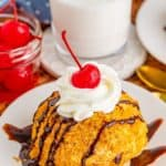 Pinterest image of one Fried Ice Cream Recipe on white plate with toppings